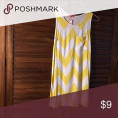NWT Tank top Tunic length white and sunny yellow chevron tank top. New with tag. Tops Tank Tops