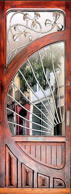 This wood and glass door with its metal cutouts is simply stunning!  While we don't have anything this ornate, you can check out some of the #EntryDoors we do install in the Minneapolis MN area.  http://www.replacementwindowsmpls.com