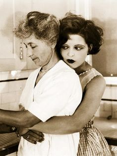Clara Bow and her cook, 1927.