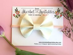 A personal favorite from my Etsy shop https://www.etsy.com/listing/499653800/leather-hair-bow-white-leather-bow-with