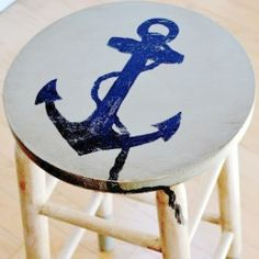 Bring summer into your home with a DIY painted nautical wooden stool from the blog Homeroad. Ahoy, mateys!