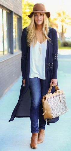Woman wearing maxi cardigan. Long navy cardigan. White T and brown booties.  Brown floppy hat and brown bag.
