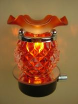 Fragrance oil burner/warmer that  plug into any wall outlet in any room of your home, oil is warmed and release fragrance into room by a 35 watt halogen light bulb.  Has dimmer switch can use as night light.