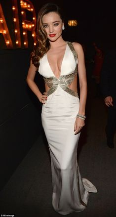 February 22, 2015: Vintage chic: A plunging neckline combined with metallic sequin detailing and a soft fisht...