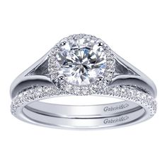 A 14k White Gold Contemporary Halo Engagement Ring.