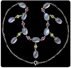 Necklace in the British suffragette colors of green, white, and violet.