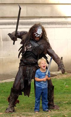 The leader of a pack of Uruk-hai from the Lord of the Rings demonstrating poor parenting skills.