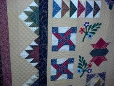 Wool applique quilt made by Shirley. Longarm quilted by Le Ann Weaver of www.persimmonquilts.com