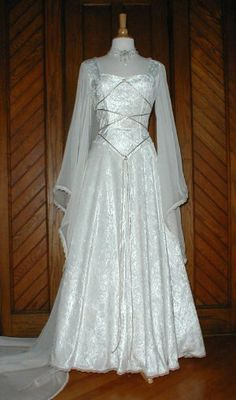A wedding dress featuring historic medieval design elements is best for a themed ceremony. A medieval wedding event gown and grooms clothes are vital,. Wedding Dress Chiffon, Bridal Dresses, Wedding Gowns, Sheer Chiffon, Wedding Card, Wedding Photos, Bridesmaid Dresses, Medieval Gown, Medieval Wedding