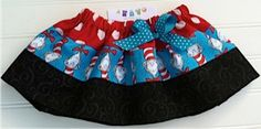 Cat in the Hat Skirt.  Available 3-6 months through 6T. $18.00, via Etsy.