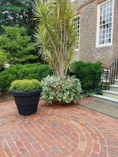 Inviting brick pathway and courtyard at Colonial Williamsburg.