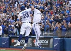 Jose Bautista of the Toronto Blue Jays celebrates his three-run home run with Josh Donaldson in the eighth inning during MLB game action against the New York Yankees on September 2016 at Rogers Centre in Toronto, Ontario, Canada. New York Yankees Baseball, Baseball Boys, Baseball Players, Josh Donaldson, Baseball Season, American League, Go Blue, Toronto Blue Jays, Rogers Centre