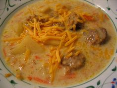 Old Farmhouse Cooking: Slow Cooker Cheddar Bratwurst Soup. Making this with venison brats for dinner tonight.