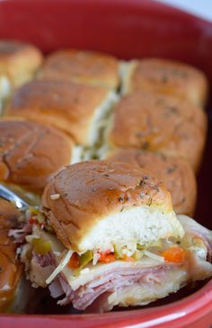 Muffalata Oven Baked Sandwiches - This Italian Sandwich is loaded with meat, cheese and olive salad. A New Orleans favorite, baked in the oven and perfect for feeding a crowd!