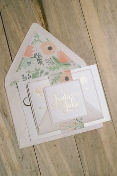 Blush and gold foil wedding invitations with Rifle Wildflower floral envelope liners and belly bands. #letterpress #foil
