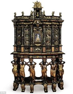 The Cucci Cabinet - one of just three cabinets crafted by Italian artist Domenico Cucci during the reign of French King Louis XIV - auctioned for more than £4.5m