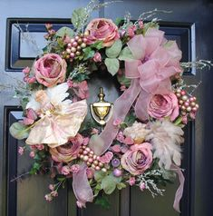 I love the non traditional pinks and greens chosen for this pretty victorian style christmas wreath.