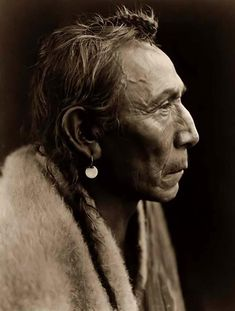 Here we present an historic image of Aki-tanni (Two Guns). It was taken in 1927 by Edward S. Curtis.    The image shows a nice profile view of an Indian.    We have created this collection of images primarily to serve as an easy to access educational tool. Contact curator@old-picture.com.    Image ID# 2D1EE452