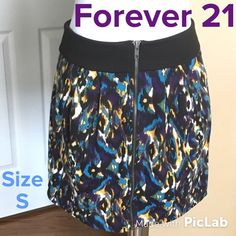 F21 Exposed Zipper Skirt Size S Excellent Condition! Exposed zipper down the front and pockets. Waist is 28 inches and Length is 16 inches. Forever 21 Skirts A-Line or Full