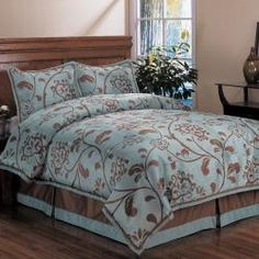 @Overstock - This comforter set showcases a bold-scale painterly floral vine constructed in a technique that emulates finest of silk weaves. This bedding set features chocolate motifs on a shimmering blue background making a dramatic graphic statement.  http://www.overstock.com/Bedding-Bath/Bella-Floral-Queen-size-Comforter-Set/5393979/product.html?CID=214117 $86.99