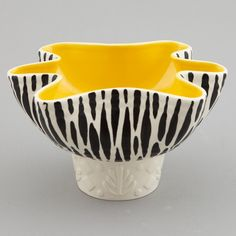 Beswick Mid Century Zebra Stripe Planter Bowl  --  Circa 1960 planter / bowl by Beswick of England has black and white zebra stripe glaze and yellow interior with fluted rim. We have several pieces in this pattern available - please inquire.  --   Item:  3152  --  Retail Price:  $295