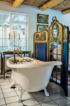 A freestanding bath is the ultimate décor element when emulating a French bathroom, especially paired with brass taps and golden trinkets.