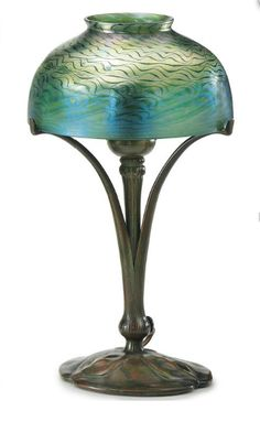 TIFFANY STUDIOS   A Favrile Glass and Bronze Table Lamp, circa 1910   12 7/8 in. (32.7 cm.) high, 7 1/8 in. (18 cm.) diameter of shade   base stamped TIFFANY STUDIOS NEW YORK 426, shade engraved L.C.T. S4952