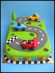 Race car cake for your boy who loves zooming around the house. Fancy Cakes, Cute Cakes, Sweet Cakes, Race Car Cakes, Racing Cake, Race Track Cake, Car Cakes For Boys, Boy Cakes, Number Cakes