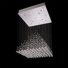 This stunningly contemporary ten light chandelier features a square chrome canopy fixture complete with a set of thirteen brightly shining Halogen lights. Description from nilimahome.com. I searched for this on bing.com/images