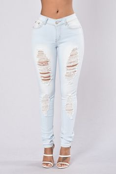 - Available in Light Blue - Mid Rise Jeans - Skinny Leg - Stretch Material - 5 Pocket Design - Distressed Leg - 80% Cotton 15% Polyester 5% Elastane