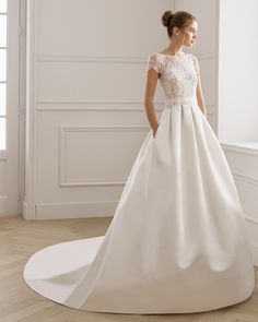 Classic wedding dress made of satin and rhinestone lace. Boat neckline and short sleeves. Available in natural white. AIRE BARCELONA Collection … - Sites new Bateau Wedding Dress, Fairy Wedding Dress, Garden Wedding Dresses, Wedding Dress Sleeves, Modest Wedding Dresses, Bridal Dresses, Wedding Dress Pockets, Sun Dresses, Simple Dresses