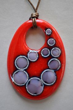 Fused Art Glass Pendant Necklace in Red, Mauve, Dusty Lilac, Silver Metal and Leather - Reactions in Fused Art Glass - Wearable Art. $60.00, via Etsy.