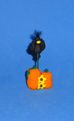 Polymer Clay Fall Crow with Pumpkins. $8.50, via Etsy.