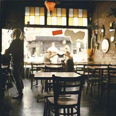 coffee bar with raw brick wall