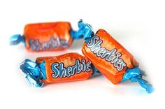 ALLEN'S Sherbies. They're a delicious orange chewy lolly outside, with sherbet inside.