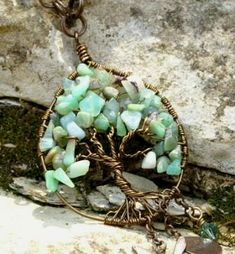 Tree of life necklace - have seen these before and I really love this one with the gem chips as the green leaves !
