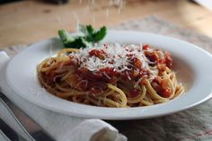 Recipe:  Basic Tomato Sauce (with Optional Zing!) Here's an idea: Use it with leftover shredded pork to make pork ragu