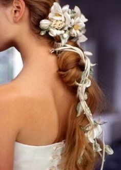 Braid wrapped in flowers and vines.
