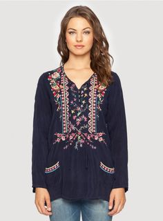 The Johnny Was FARRAH BLOUSE embodies boho-chic style! This embroidered peasant blouse features a feminine floral embroidery design in colorful pink, red, blue, and yellow.