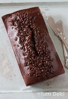 Chocolate Pound Cake - a rich chocolate pound cake with a ribbon of tangy cream cheese and chocolate chip topping.