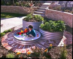 Sand box idea with planters as well.