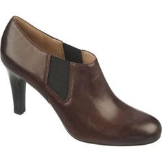 """This round-toe, pull-on bootie has a 3-inch stacked heel and elastic side gores for a snug yet flexible fit. Heel Height: 3"""" Origin: Imported Fit: True to Size Outsole: Synthetic Upper: Leather Specia"""