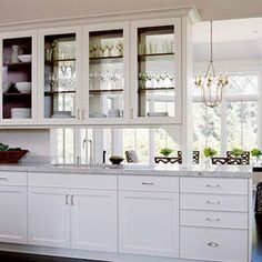 Glass on both sides on the cabinets over a peninsula---not all the way to the walk thru to avoid hitting head?