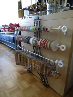 Perfect craft room storage with curtain rods -- I like the idea of the bottom rod, too
