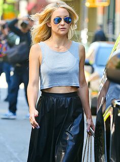 Kate Hudson in leather skirt, cropped tank and aviators.