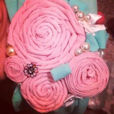 Made this from a pair of tights, leftover fabric, an old button & faux pearls. Mint and blush headband.