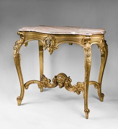 Late century hand carved Italian Rococo gilded center table supporting a rustico-grigio marble top. The table features an asymmetrical carved Rococo Furniture, Art Deco Furniture, French Furniture, Classic Furniture, Furniture Styles, Wooden Furniture, Furniture Design, Italian Furniture, French Rococo