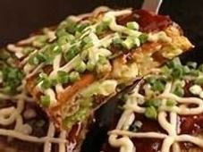 Monjayaki & Okonomiyaki Experience, Tokyo.  They cook in front of you, and let you try to cook yourself.  | Japan Gourmet Experience