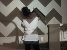 Rather than using math to map out a chevron (or other pattern) on a wall, use a projector.  Genius!