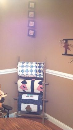Tobacco stick quilt rack ... so easy    will be great to hang her blankets on